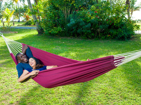 Couple lying in Arte Vino double hammock