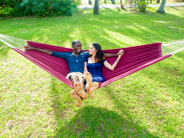 Arial view of couple lying in Arte Vino double hammock