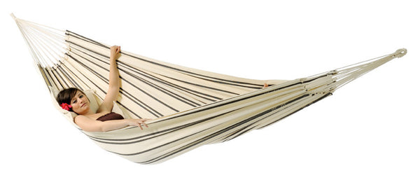 Woman lying in cappuccino with thin brown stripes Barbados hammock