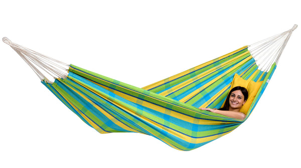 Girl relaxing in green blue yellow striped Lemon Barbados hammock