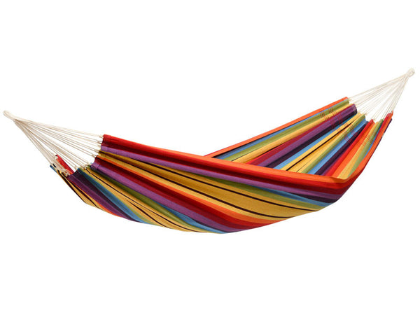 Hanging empty Barbados hammock in Rainbow colourful stripes