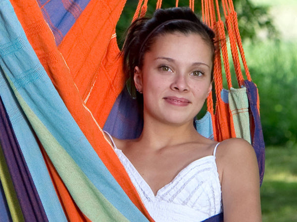 Closeup of girl in orange striped Mandarina Bogata hammock chair.