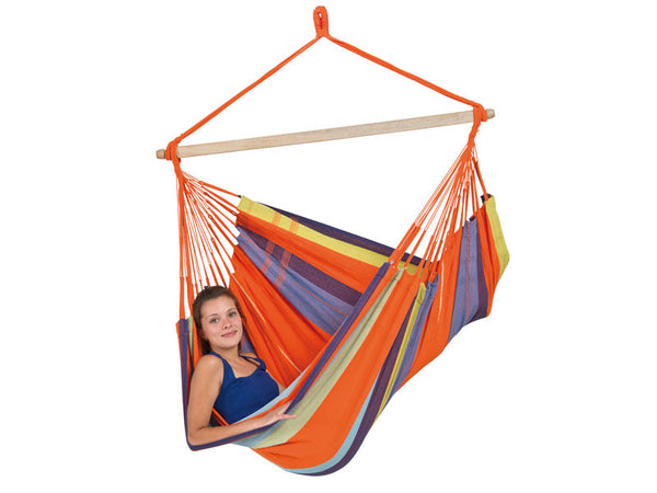 Girl sat sideways in orange striped Mandarina Bogata hammock chair with white background.