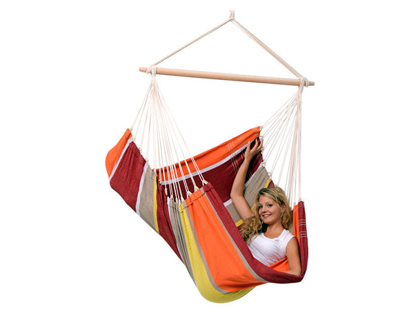 Woman sat sideways in Brasil Acerola Hammock Chair with white background.