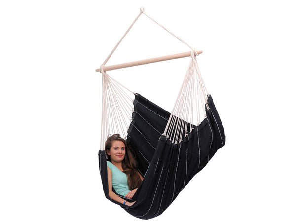Woman sat sideways in Brasil Black Hammock Chair with white background.