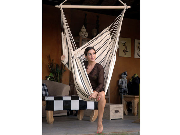 Woman sat in Cappuccino Brasil Hammock Chair indoors.
