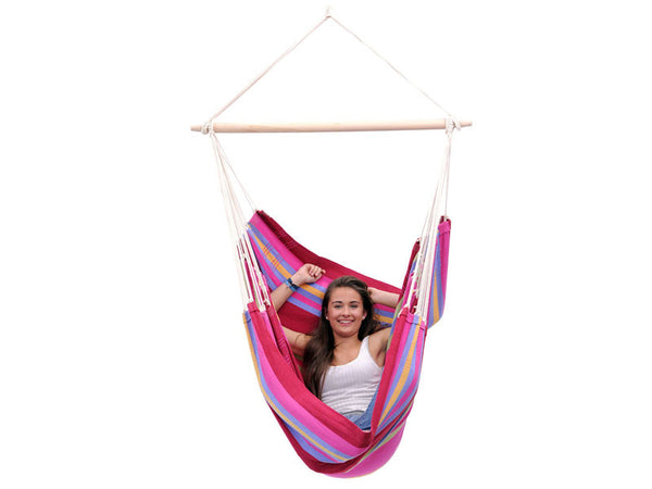 Woman sat in Brasil Grenadine Hammock Chair with white background.