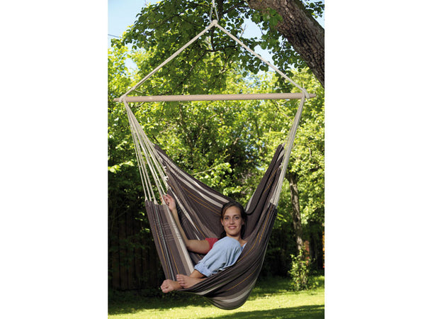 Woman sat legs up in Cafe Brasil Gigante Hammock Chair in garden.