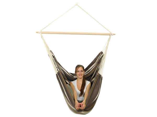 Woman sat in Brasil Gigante Cafe Hammock Chair with white background.