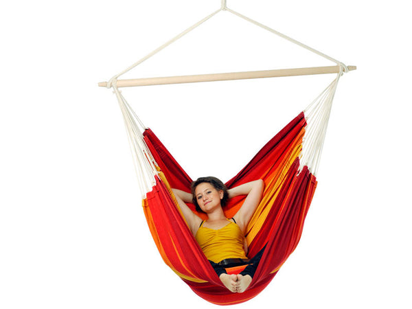 Woman relaxing in Brasil Gigante Lava Hammock Chair with white background.