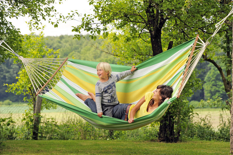 Woman and child in striped green yellow white Brasilia hammock with spreader bar