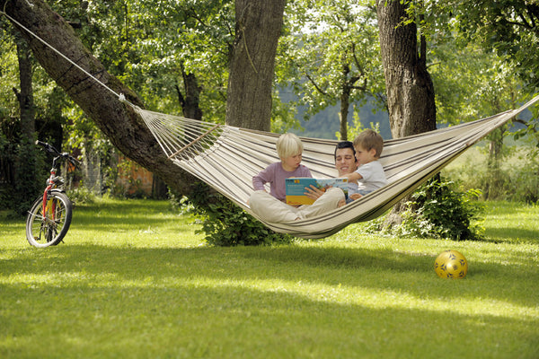 Man with children sitting in cappucinno with brown stripes Brasilia hammock with spreader bar