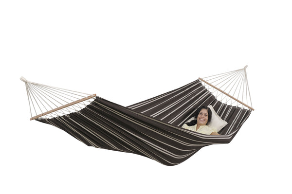 Woman lying in mocca with stripes Brasilia hammock with spreader bar
