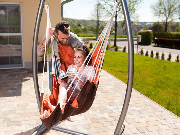 Woman sat in California Hanging Chair with Stand Set on terrace
