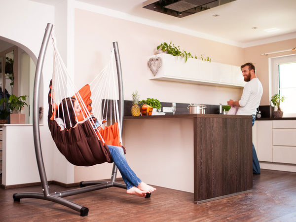 Woman sat indoors in California Hanging Chair with Stand Set
