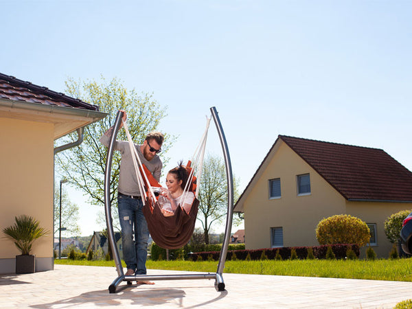 Woman sat  on terrace in California Hanging Chair with Stand Set