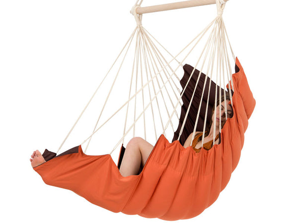 Side view of girl sat in California Terracotta Hanging Chair