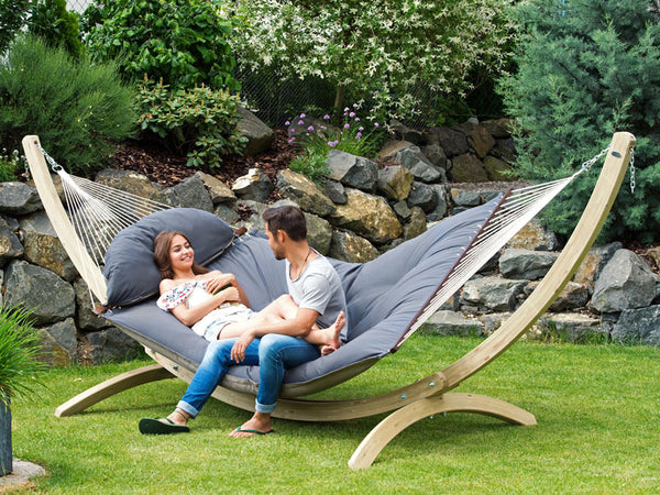 Couple sitting on Fat Hammock on Olymp Stand in garden