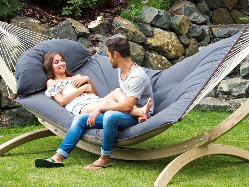 Couple sitting on Fat Hammock