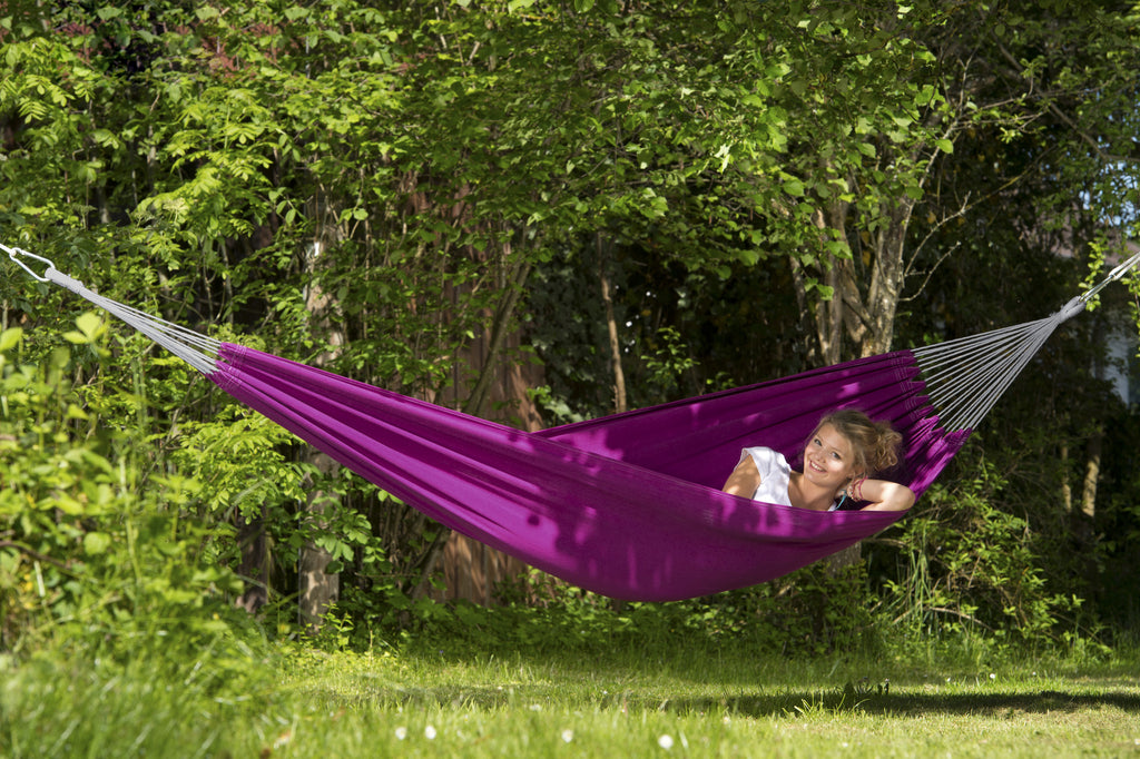 Woman lying in Berry purple Florida hammock