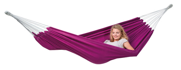 Woman sitting up in Berry purple Florida hammock