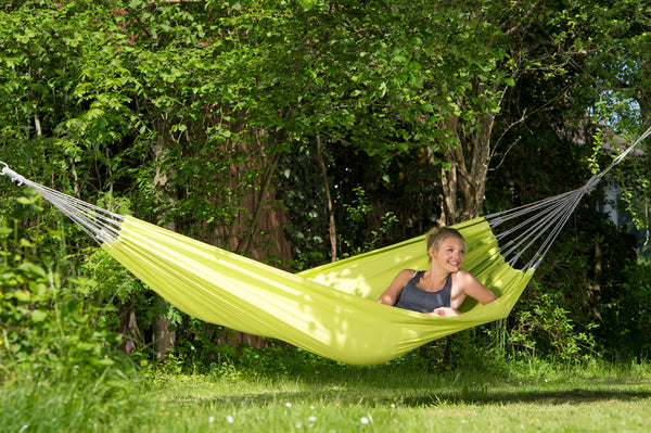 Girl lying and looking out in Kiwi green Florida hammock