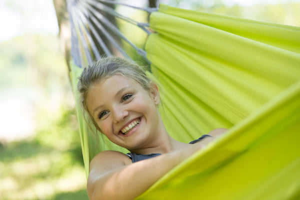 Close up of girl lying and looking out in Kiwi green Florida hammock