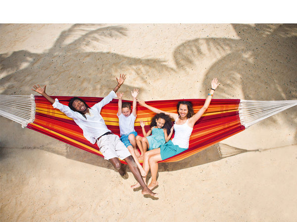 Aerial shot of family on beach in red orange striped Gigante Lava hammock