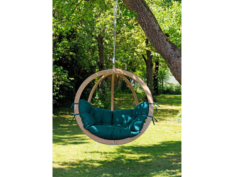 Globo Single Green Wooden Swing Chair hanging from tree.