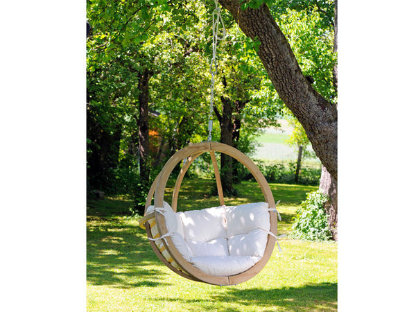 Globo Single Natura Wooden Swing Chair hanging from tree.