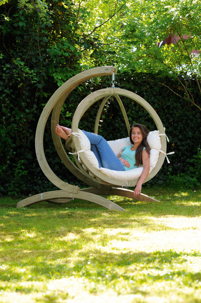 Woman sat in Globo Single Natura Wooden Swing Chair Set