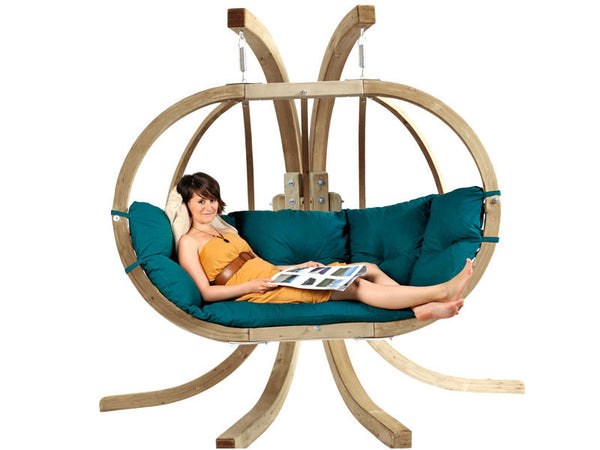Woman lying in green Globo Royal Double Wooden Hanging Chair