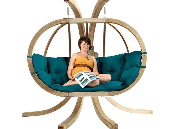Woman Sat in green Globo Royal Double Wooden Hanging Chair