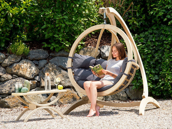 Woman sat in Globo Single Anthracite Wooden Swing Chair Set