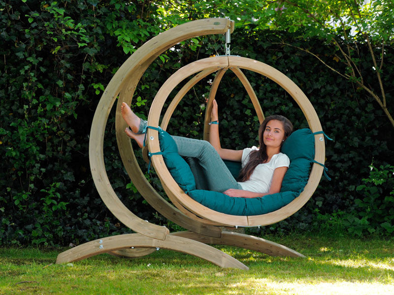 Woman sat in Globo SingleGreen Wooden Swing Chair Set