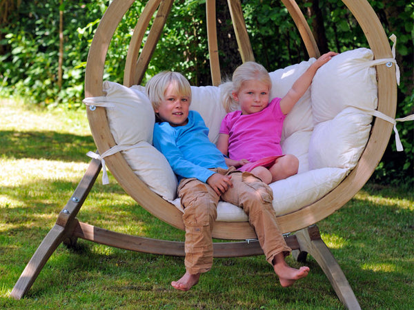 Children sat in Globo Single Natura Wooden Swing Chair Set