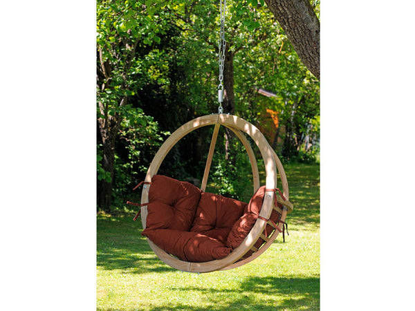 Globo Single Terracotta Wooden Swing Chair hanging from tree.