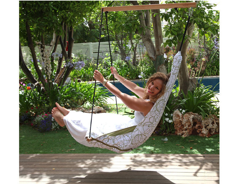 Woman swinging in Peppermint Hang Solo Hammock Chair.
