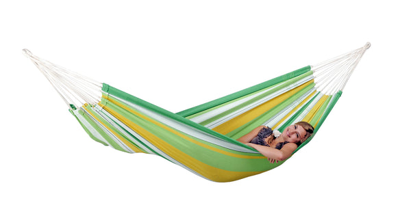 Girl lying in striped green yellow white striped Apple Lambada hammock