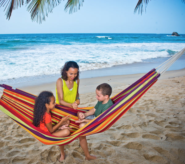 Children on beach in colourful striped Tropical Lambada hammock