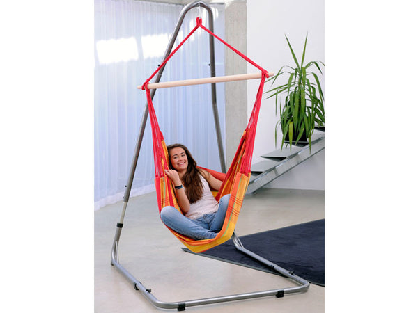 Girl sat in hammock chair suspended by Luna Rockstone Stand.