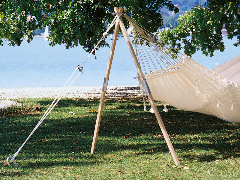 madera hammock stand supporting hammock next to a lake  amazonas wooden tripod hammock stand   madera   hammock barn  rh   hammockbarn co uk