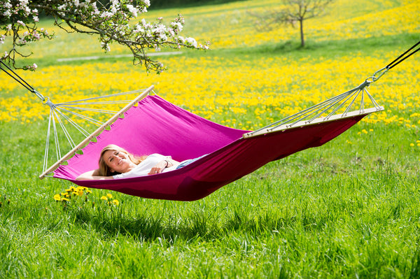 Woman lying on Berry purple Miami hammock.