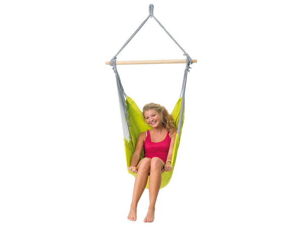 Girl sat in kiwi Panama hammock chair with white background.