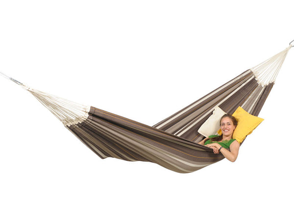 Woman lying in cafe Paradiso hammock with white background.