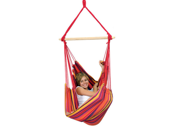Girl sat in vulcano Relax hanging chair with white background.