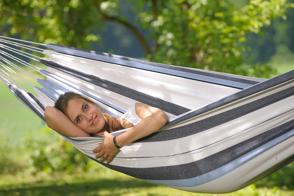 Close up of girl lying in blues and white striped Salsa Marine hammock