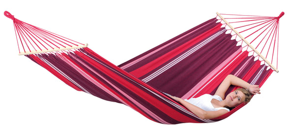 Girl relaxing in purple stripes Samba Fuego hammock with spreader bar