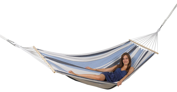 Girl relaxing in blues and white striped Samba Marine hammock with spreader bar