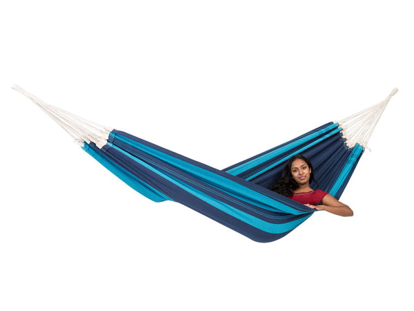Woman lying in striped Blue Santana hammock